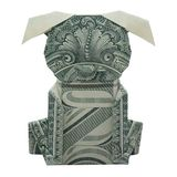 Le chiot d'origami d'argent s'est plié avec le vrai un dollar Bill Isolated image libre de droits