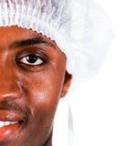 Le chirurgien aîné en vert frotte Photos libres de droits