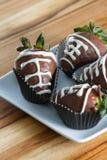 Le chocolat de cuvette de dîner a couvert des fraises Photographie stock