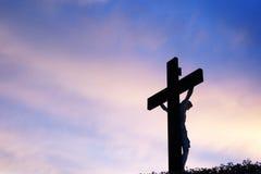 Le Christ au coucher du soleil images stock