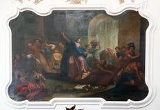 Le Christ conduisant les commutateurs d'argent par le temple Photos stock