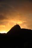 Le Christ dans des lumières de coucher du soleil Photographie stock libre de droits