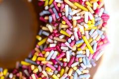 Le ciambelle lustrate con spruzza Immagini Stock Libere da Diritti