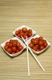 Le ciliege dei pomodori sono servite Fotografie Stock Libere da Diritti