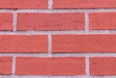 Le ciment horizontal de pierre de rectangle de rangée de mur de briques rouge barre le style urbain de style de plan rapproché de photographie stock