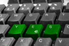 Le clavier marque avec des lettres l'orthographe oui Images stock