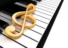 Le clef triple est sur le piano Photo stock
