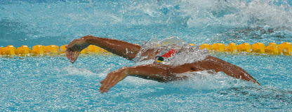 LE CLOS Chad RSA. Hong Kong, China - Oct 29, 2016. Olympic and world champion swimmer LE CLOS Chad RSA swimming in the Men`s Butterfly 100m Preliminary Heat Royalty Free Stock Images