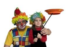 Le clown effectuent le trics photographie stock