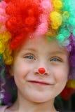 Le clownen Child Arkivfoto