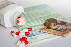 Le coût réel du système de NHS photographie stock libre de droits