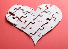 Le coeur brisé fait en puzzle Photographie stock