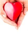 Le coeur dans la femelle remet le blanc Photo libre de droits