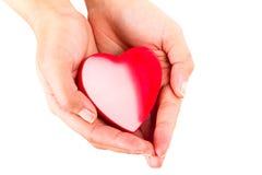 Le coeur dans la femelle remet le blanc Image libre de droits