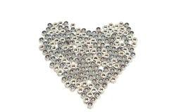 Le coeur de fer a effectué des noix de forme Photographie stock libre de droits