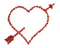 le coeur de flèche a percé le valentine simple de s Photo libre de droits