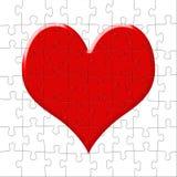 Le coeur de rouge de puzzle Photos stock
