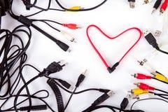 Le coeur des fils entourés par un audio de fond de cadre câble Photo libre de droits