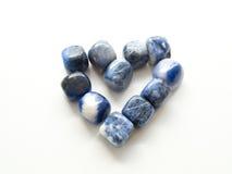 Le coeur du jaspe Tumbled lapide pour les traitements en cristal de thérapie photographie stock