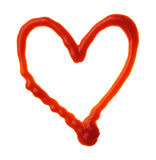 Le coeur est fait de ketchup Photos stock