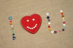 Le coeur et les mots I aiment l'écriture d'U avec les boutons de couture Image libre de droits