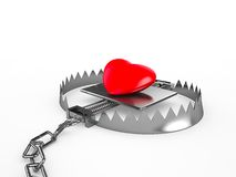 Coeur rouge dans un piège, d'isolement sur le fond blanc Image stock