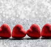 Le coeur rouge sur le fond de scintillement pour le jour de valentines Images libres de droits