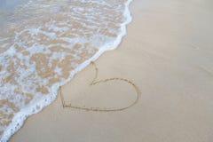Le coeur se connectent la plage Élément de conception Photographie stock