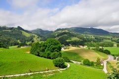 Le colline si avvicinano al castello di Gruyeres, Svizzera Fotografie Stock
