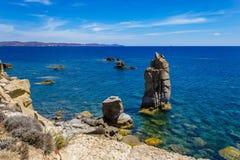 Le Colonne of Carloforte Island of San Pietro, Carbonia-Iglesi. Sea view of the volcanic rock pillars called Le Colonne near Carloforte Island of San Pietro Stock Photo