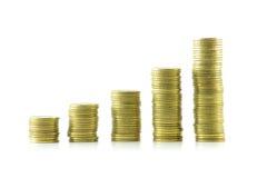 Le colonne lucidano le monete Fotografia Stock