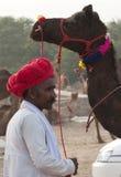 Le commerçant de chameau de Pushkar Photos stock