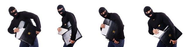 Le concept d'espionnage industriel avec la personne dans le passe-montagne Photographie stock libre de droits