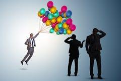 Le concept d'incertitude avec l'homme d'affaires confus Image stock