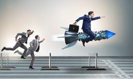 Le concept de concurrence avec l'homme d'affaires et la fusée Photos stock