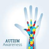 Le concept de conscience d'autisme avec la main du puzzle rapièce Photo stock
