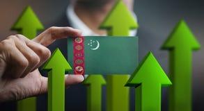 Le concept de croissance de nation, verdissent vers le haut des flèches - homme d'affaires Holding Car image libre de droits