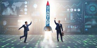 Le concept de démarrage avec la fusée et l'homme d'affaires Photographie stock libre de droits