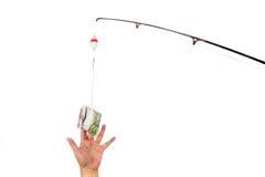 Le concept de la main atteignant pour l'argent casted comme amorce sur pêcher lin Images stock