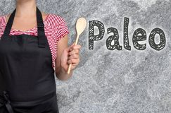 Le concept de Paleo est montré par le cuisinier images libres de droits