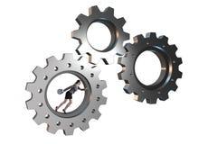 Le concept de travail d'équipe avec des roues dentées et des gens d'affaires Photographie stock