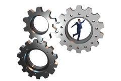 Le concept de travail d'équipe avec des roues dentées et des gens d'affaires Photo libre de droits