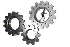 Le concept de travail d'équipe avec des roues dentées et des gens d'affaires Photos libres de droits