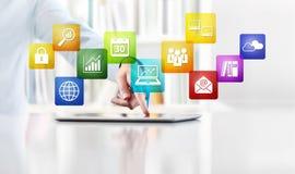 Le concept de travail d'affaires de bureau, écran tactile de main colore des icônes de Images libres de droits