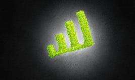 Le concept des opérations bancaires et de l'investissement a présenté avec le graphique vert de planète Photographie stock