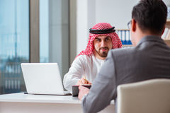 Le concept divers d'affaires avec l'homme d'affaires arabe photos stock