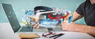 Le concepteur employant la technologie 3D en verre de réalité virtuelle ren Photographie stock libre de droits