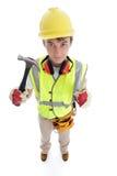 Le constructeur tenant le marteau manie maladroitement vers le haut du succès d'approbation Photos stock