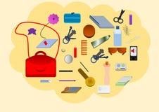 Le contenu du sac de Madame Image stock