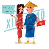 Le coppie del Vietnam pagano il rispetto o dicono ciao nello stile vietnamita - VE Immagini Stock Libere da Diritti